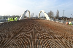 The bridge's metal structure is in place ready for a concrete pour.