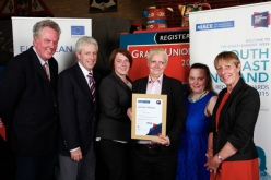 Chrissy Abraham, third from right, receives NIACE's Learning to Achieve Award. Click image to download.