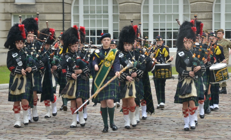 The Gordon School pipe band open ceremony by marching into County Hall courtyard