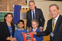 Philip Hammond MP (centre) is pictured with Tracy Creasey, head teacher at Manby Lodge, Bernie Pryor, the school's chair of governors and pupils in year one at the school
