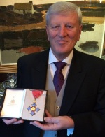 Surrey Leader receives CBE from the Queen