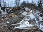 Reality TV businessman guilty of allowing huge illegal rubbish tip to build up in Surreycountryside